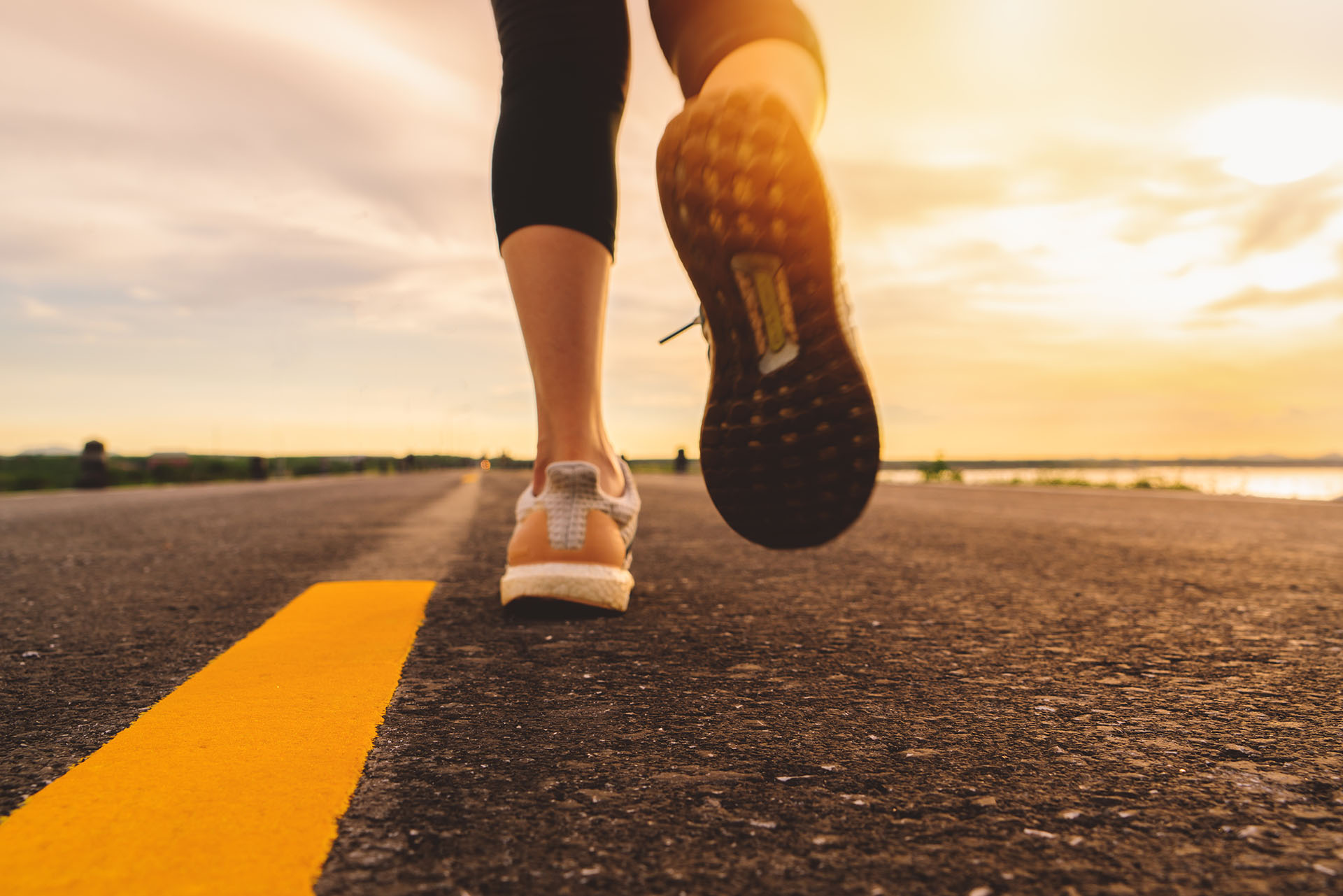 Athlete,Running,On,The,Road,Trail,In,Sunset,Training,For